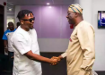 Olamide in a handshake with Sanwo-Olu